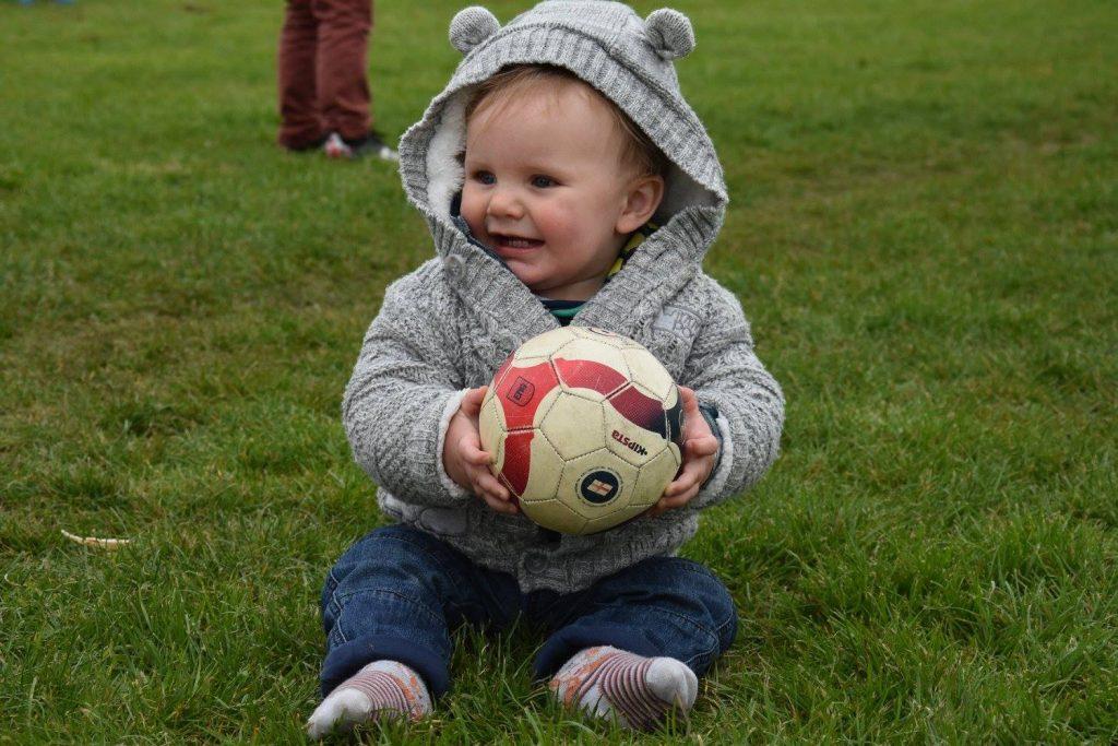 Little baby boy holding a ball