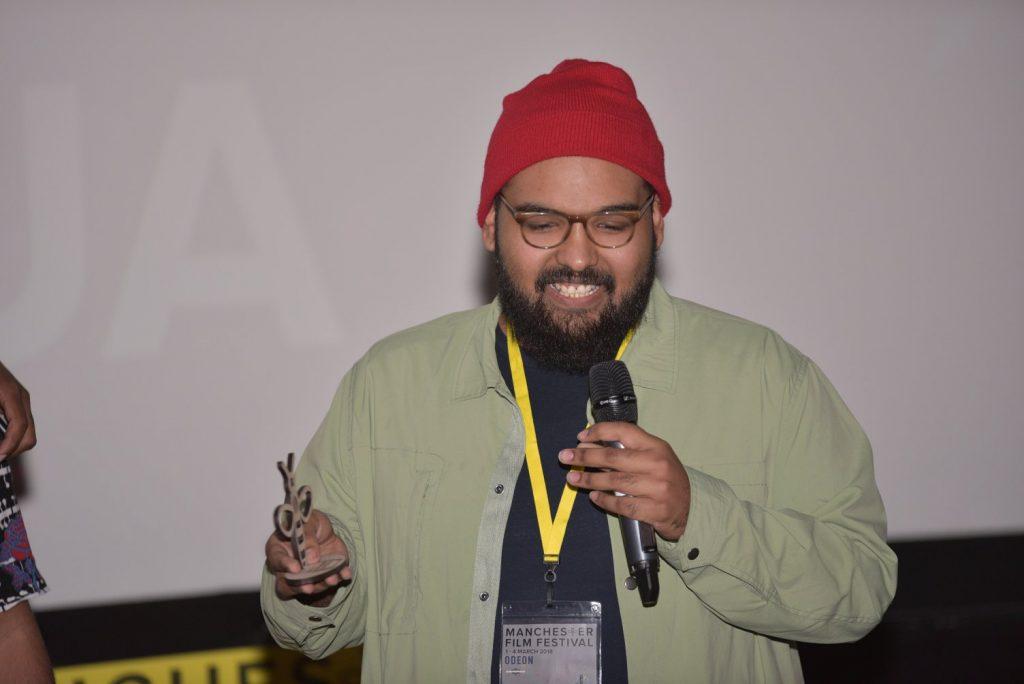 Manchester film festival, a gentleman presenting
